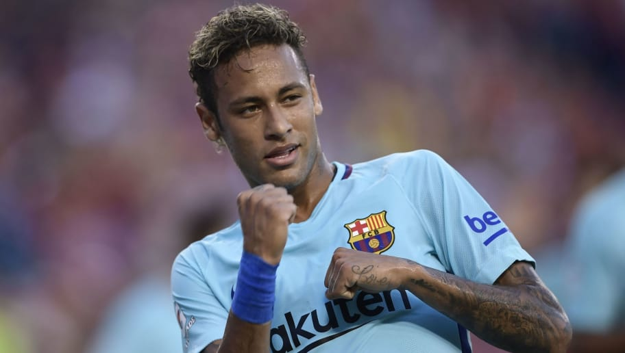 Neymar of Barcelona gestures after scoring during their International Champions Cup (ICC) football match against Manchester United on July 26, 2017 at the FedExField, in Landover, Maryland.  / AFP PHOTO / Brendan Smialowski        (Photo credit should read BRENDAN SMIALOWSKI/AFP/Getty Images)