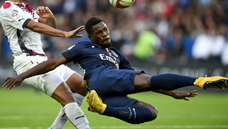 Bordeaux's French Tunisian midfielder Wahbi Khazri (L) vies with Paris Saint-Germain's French defender Serge Aurier during the French L1 football match between Paris Saint-Germain (PSG) and Bordeaux (FCGB), at the Parc des Princes stadium in Paris on October 25, 2014.  AFP PHOTO / FRANCK FIFE        (Photo credit should read FRANCK FIFE/AFP/Getty Images)