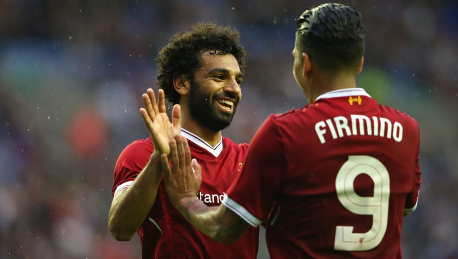 WIGAN, ENGLAND - JULY 14:  Mohamed Salah of Liverpool celebrates with Roberto Firmino after scoring their first goal during the pre-season friendly match between Wigan Athletic and Liverpool at DW Stadium on July 14, 2017 in Wigan, England.  (Photo by Alex Livesey/Getty Images)