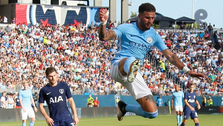 NASHVILLE, TN - JULY 29:  Kyle Walker #2 of Manchester City jumps over goaltender Hugo Lloris #1 of Tottenham during the first half of the 2017 International Champions Cup Presented by Heineken at Nissan Stadium on July 29, 2017 in Nashville, Tennessee.  (Photo by Frederick Breedon/Getty Images)