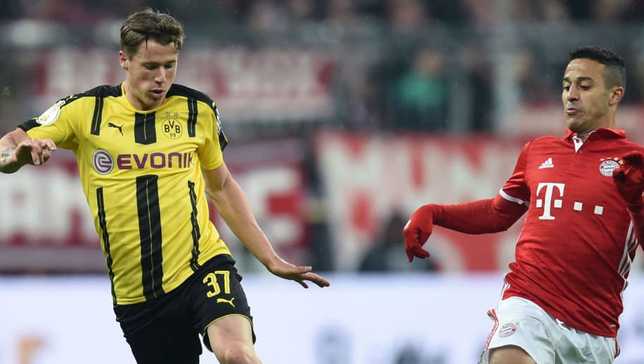 Dortmund's defender Erik Durm (L) and Bayern Munich's Spanish midfielder Thiago Alcantara vie for the ball during the German Cup DFB Pokal semifinal football match between FC Bayern Munich and BVB Borussia Dortmund in Munich, on April 26, 2017. / AFP PHOTO / Christof STACHE / RESTRICTIONS: ACCORDING TO DFB RULES IMAGE SEQUENCES TO SIMULATE VIDEO IS NOT ALLOWED DURING MATCH TIME. MOBILE (MMS) USE IS NOT ALLOWED DURING AND FOR FURTHER TWO HOURS AFTER THE MATCH. == RESTRICTED TO EDITORIAL USE == FOR MORE INFORMATION CONTACT DFB DIRECTLY AT +49 69 67880   /         (Photo credit should read CHRISTOF STACHE/AFP/Getty Images)