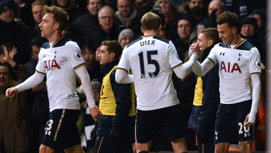 Tottenham Hotspur's English midfielder Dele Alli (R) celebrates with teammates after scoring his and Totenham's second goal during the English Premier League football match between Tottenham Hotspur and Chelsea at White Hart Lane in London, on January 4, 2017. / AFP / IKIMAGES / IKIMAGES / RESTRICTED TO EDITORIAL USE. No use with unauthorized audio, video, data, fixture lists, club/league logos or 'live' services. Online in-match use limited to 45 images, no video emulation. No use in betting, games or single club/league/player publications.        (Photo credit should read IKIMAGES/AFP/Getty Images)