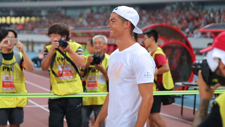 Real Madrid player Christiano Ronaldo attends an event as part of his individual promotional tour of China, in Shanghai on July 22, 2017. / AFP PHOTO / STR / China OUT        (Photo credit should read STR/AFP/Getty Images)