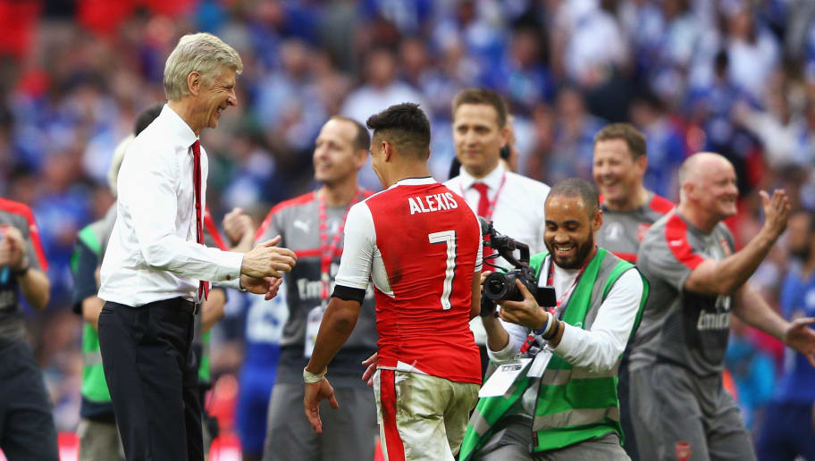 LONDON, ENGLAND - MAY 27: Arsene Wenger, Manager of Arsenal and Alexis Sanchez of Arsenal celebrate after The Emirates FA Cup Final between Arsenal and Chelsea at Wembley Stadium on May 27, 2017 in London, England.  (Photo by Ian Walton/Getty Images)