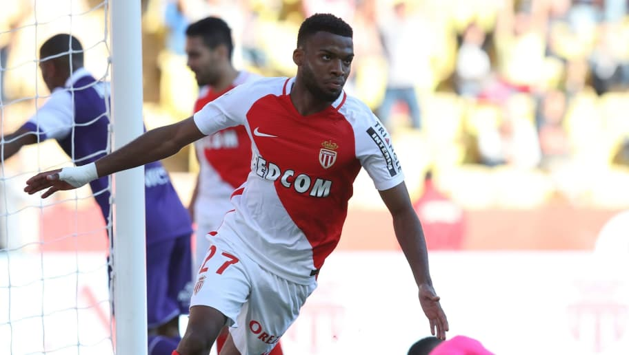 Monaco's French midfielder Thomas Lemar celebrates after scoring a goal during the French L1 football match Monaco (ASM) vs Toulouse (TFC) on April 29, 2017 at the 'Louis II Stadium' in Monaco. / AFP PHOTO / VALERY HACHE        (Photo credit should read VALERY HACHE/AFP/Getty Images)