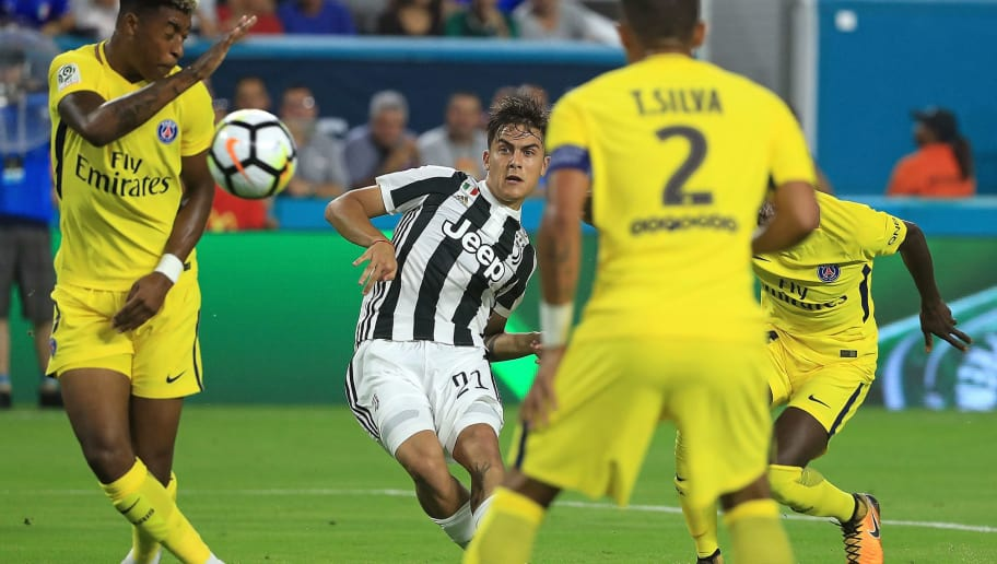 MIAMI GARDENS, FL - JULY 26:  Paulo Dybala #21 of Juventus takes a shot on goal during the International Champions Cup 2017 match against the Paris Saint-Germain at Hard Rock Stadium on July 26, 2017 in Miami Gardens, Florida.  (Photo by Mike Ehrmann/Getty Images)