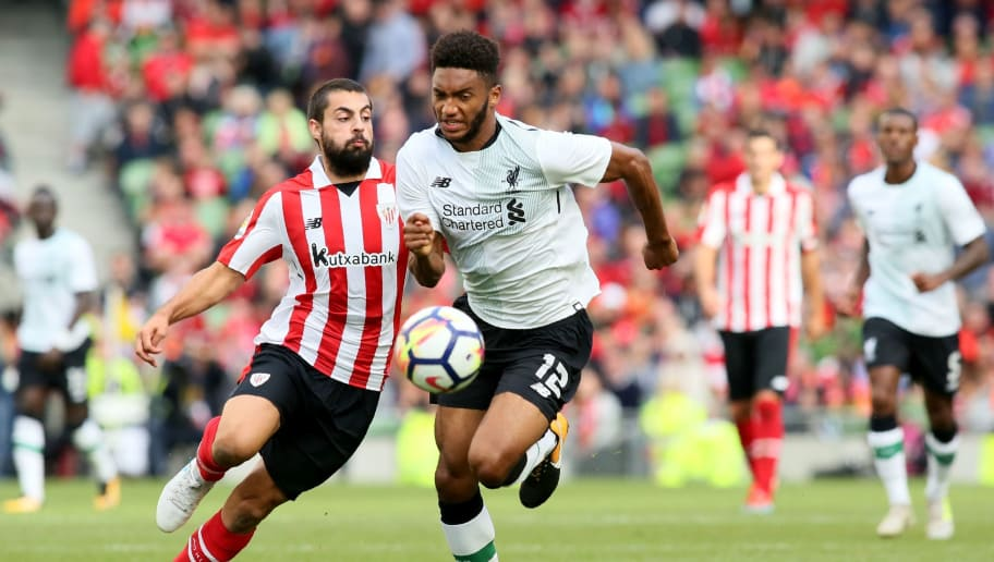 Athletic's Spanish striker Asier Villalibre (L) vies with Liverpool's English defender Joe Gomez during the pre-season friendly football match between Athletic Bilbao and Liverpool at Aviva stadium in Dublin, Ireland on August 5, 2017.  / AFP PHOTO / Paul FAITH        (Photo credit should read PAUL FAITH/AFP/Getty Images)