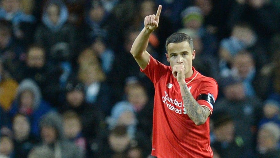 Liverpool's Brazilian midfielder Philippe Coutinho celebrates after scoring their second goal during the English Premier League football match between Manchester City and Liverpool at The Etihad stadium in Manchester, north west England on November 21, 2015. AFP PHOTO / OLI SCARFF  RESTRICTED TO EDITORIAL USE. No use with unauthorized audio, video, data, fixture lists, club/league logos or 'live' services. Online in-match use limited to 75 images, no video emulation. No use in betting, games or single club/league/player publications.        (Photo credit should read OLI SCARFF/AFP/Getty Images)