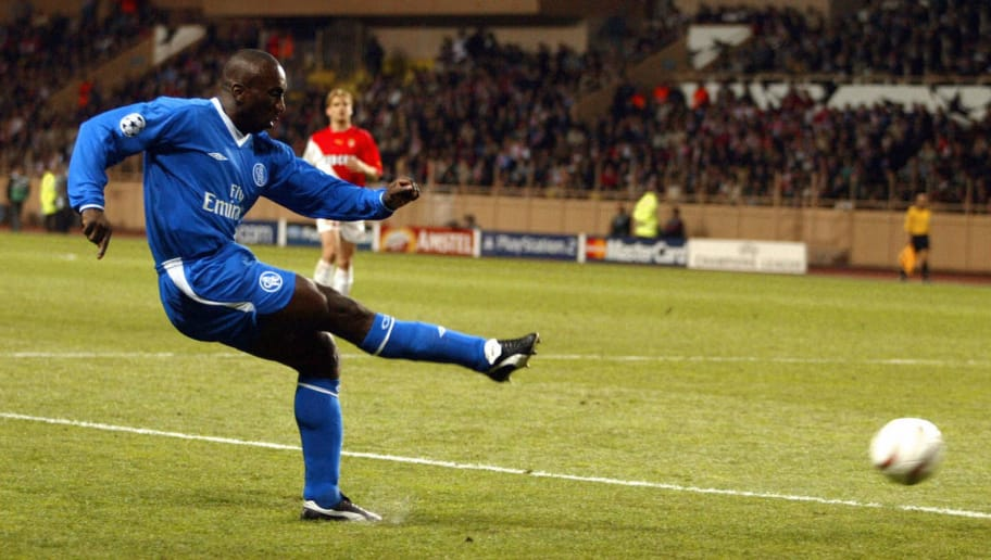 MONACO, Monaco:  Chelsea's Dutch forward Jimmy Floyd Hasselbaink kicks the ball during his Champions League semi-final first-leg football match against Monaco, 20 April 2004 at the Louis II stadium in Monaco. Monaco won 3-1.  AFP PHOTO JIM WATSON  (Photo credit should read JIM WATSON/AFP/Getty Images)