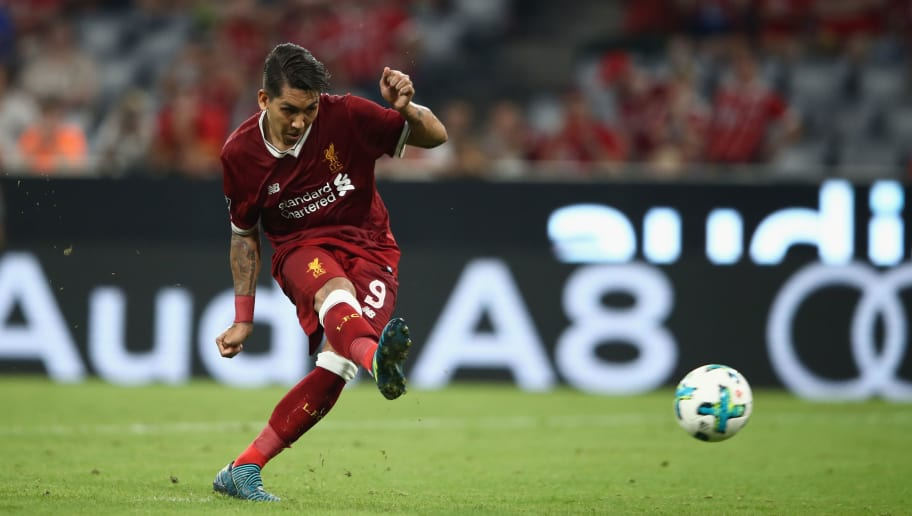 MUNICH, GERMANY - AUGUST 02: Roberto Firmino of Liverpool FC scores from the penalty spot during the Audi Cup 2017 match between Liverpool FC v Atletico Madrid at Allianz Arena on August 2, 2017 in Munich, Germany. (Photo by Alex Grimm/Bongarts/Getty Images for Audi)