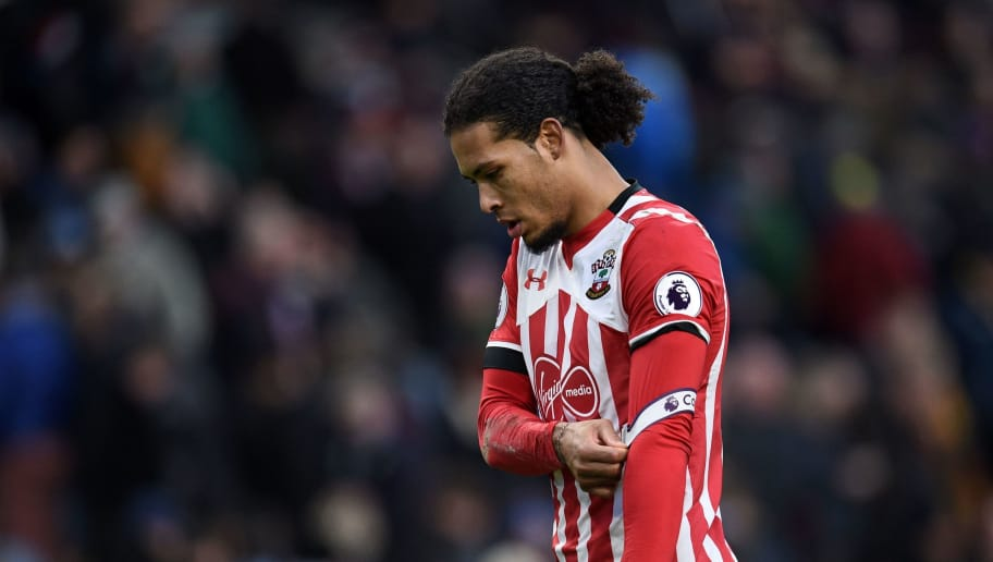 Southampton's Dutch defender Virgil van Dijk walks from the pitch at half time in the English Premier League football match between Burnley and Southampton at Turf Moor in Burnley, north west England on January 14, 2017. / AFP / Oli SCARFF / RESTRICTED TO EDITORIAL USE. No use with unauthorized audio, video, data, fixture lists, club/league logos or 'live' services. Online in-match use limited to 75 images, no video emulation. No use in betting, games or single club/league/player publications.  /         (Photo credit should read OLI SCARFF/AFP/Getty Images)