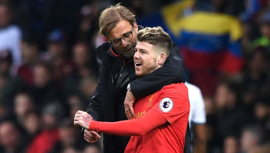 WEST BROMWICH, ENGLAND - APRIL 16:  Jurgen Klopp, Manager of Liverpool and Alberto Moreno of Liverpool embrace after the Premier League match between West Bromwich Albion and Liverpool at The Hawthorns on April 16, 2017 in West Bromwich, England.  (Photo by Stu Forster/Getty Images)