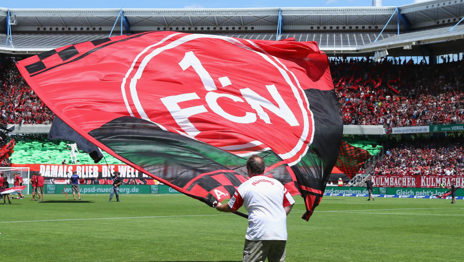 NUREMBERG, GERMANY - JULY 30: Fans of Nuernberg wave their flags prior to the Second Bundesliga match between 1. FC Nuernberg and 1. FC Kaiserslautern at Max-Morlock-Stadion on July 30, 2017 in Nuremberg, Germany.  (Photo by Alex Grimm/Bongarts/Getty Images)