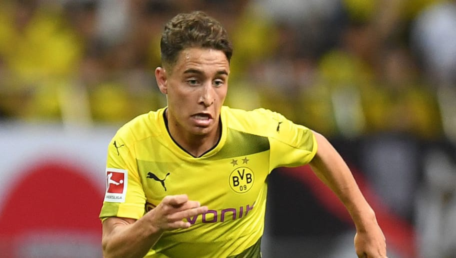 SAITAMA, JAPAN - JULY 15:  Emre Mor of Borussia Dortmund runs with the ball during the preseason friendly match between Urawa Red Diamonds and Borussia Dortmund at Saitama Stadium on July 15, 2017 in Saitama, Japan.  (Photo by Atsushi Tomura/Getty Images)