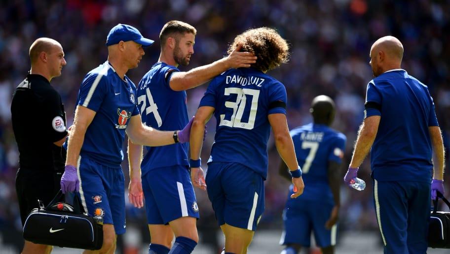 LONDON, ENGLAND - AUGUST 06:  Gary Cahill of Chelsea and David Luiz of Chelsea embrace after they clash heads during the The FA Community Shield final between Chelsea and Arsenal at Wembley Stadium on August 6, 2017 in London, England.  (Photo by Dan Mullan/Getty Images)