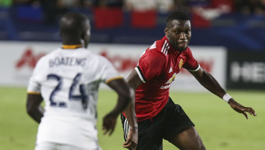 Manchester United Timothy Fosu-mensah (R) drives the ball against Los Angeles Galaxy's Emmanuel Boateng during the second half of a national friendly soccer game at StubHub Center on July 15, 2017 in Carson, California.   Manchester United won 5-2.  / AFP PHOTO / RINGO CHIU        (Photo credit should read RINGO CHIU/AFP/Getty Images)