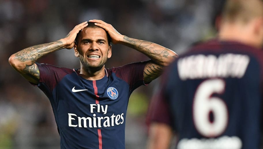 Paris Saint-Germain's Brazilian defender Dani Alves reacts during the French Trophy of Champions (Trophee des Champions) football match between Monaco (ASM) and Paris Saint-Germain (PSG) on July 29, 2017, at the Grand Stade in Tangiers. / AFP PHOTO / FRANCK FIFE        (Photo credit should read FRANCK FIFE/AFP/Getty Images)