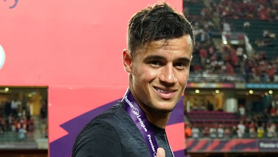 HONG KONG - JULY 22: Philippe Coutinho of Liverpool celebrates after beating Leicester City 2-1 in the final during the Premier League Asia Trophy match between Liverpool FC and Leicester City FC at Hong Kong Stadium on July 22, 2017 in Hong Kong, Hong Kong.  (Photo by Stanley Chou/Getty Images )