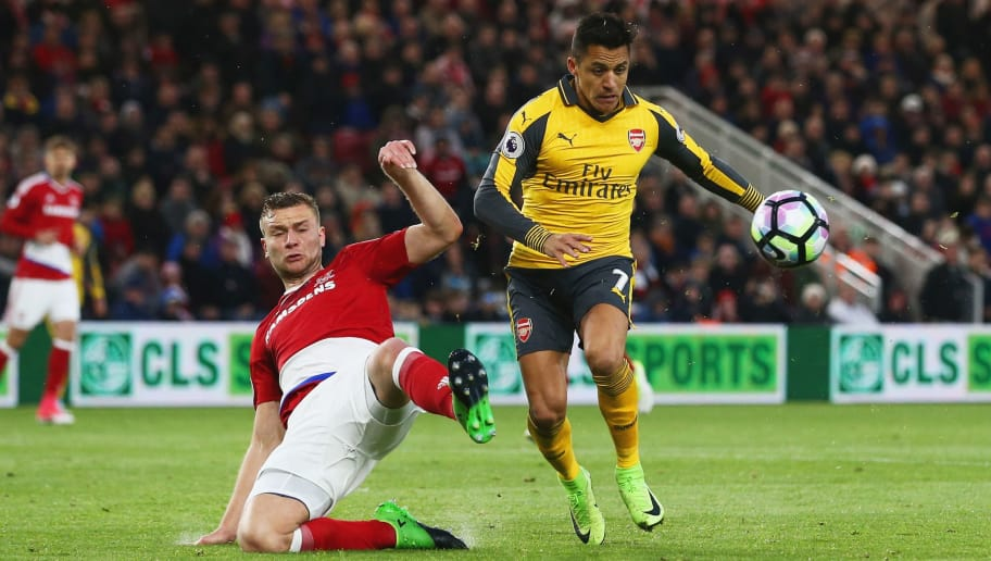 MIDDLESBROUGH, ENGLAND - APRIL 17:  Alexis Sanchez of Arsenal is challenged by Ben Gibson of Middlesbrough during the Premier League match between Middlesbrough and Arsenal at Riverside Stadium on April 17, 2017 in Middlesbrough, England.  (Photo by Jan Kruger/Getty Images)