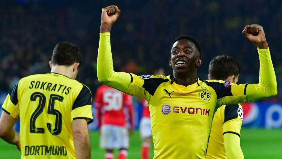 Dortmund's French midfielder Ousmane Dembele (R) celebrates the 3-0 goal during the UEFA Champions League Round of 16, 2nd-leg football match Borussia Dortmund v SL Benfica in Dortmund, western Germany on March 8, 2017. / AFP PHOTO / John MACDOUGALL        (Photo credit should read JOHN MACDOUGALL/AFP/Getty Images)