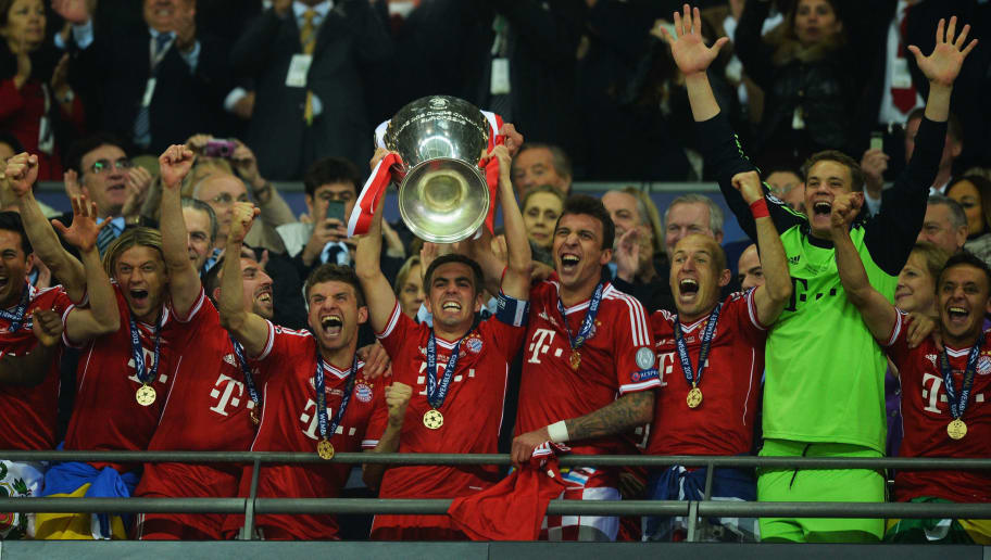 LONDON, ENGLAND - MAY 25:  Captain Philipp Lahm of Bayern Muenchen lifts the trophy in celebration after victory in the UEFA Champions League final match between Borussia Dortmund and FC Bayern Muenchen at Wembley Stadium on May 25, 2013 in London, United Kingdom.  (Photo by Laurence Griffiths/Getty Images)