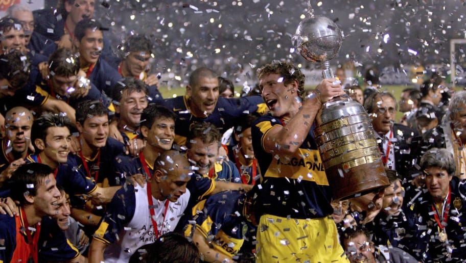 Porto Alegre, BRAZIL: Boca Juniors team captain Martin Palermo holds the Libertadores Cup trophy won after defeating Gremio by 2-0, 20 June 2007 in their final match played at Olimpico stadium in Porto Alegre, Brazil.AFP PHOTO/ORLANDO KISSNER (Photo credit should read ORLANDO KISSNER/AFP/Getty Images)