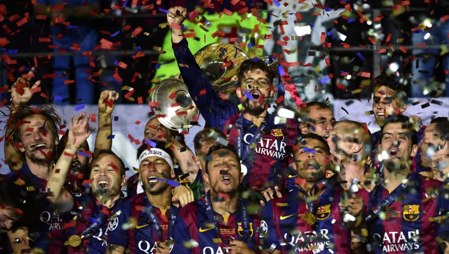 Barcelona's team celebrates with the trophy after winning the UEFA Champions League Final football match between Juventus and FC Barcelona at the Olympic Stadium in Berlin on June 6, 2015.    AFP PHOTO / OLIVIER MORIN        (Photo credit should read OLIVIER MORIN/AFP/Getty Images)