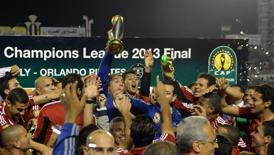 Egyptian al-Ahly coach Mohamed Youssef holds up the African Champions League trophy in Cairo, on November 10, 2013, after defeating Orlando Pirates of South Africa 2-0 in the second leg of the final. Ahly, who have previously won Africas foremost club competition in 1982, 1987, 2001, 2005, 2006, 2008, 2012, won 3-1 on aggregate after a 1-1 stalemate in the first leg. AFP PHOTO / KHALED DESOUKI        (Photo credit should read KHALED DESOUKI/AFP/Getty Images)