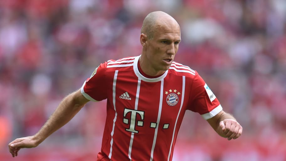 Bayern Munich's Dutch midfielder Arjen Robben plays the ball during the German first division Bundesliga football match FC Bayern Munich vs SC Freiburg in the stadium of Munich, southern Germany, on May 20, 2017. / AFP PHOTO / Christof STACHE        (Photo credit should read CHRISTOF STACHE/AFP/Getty Images)