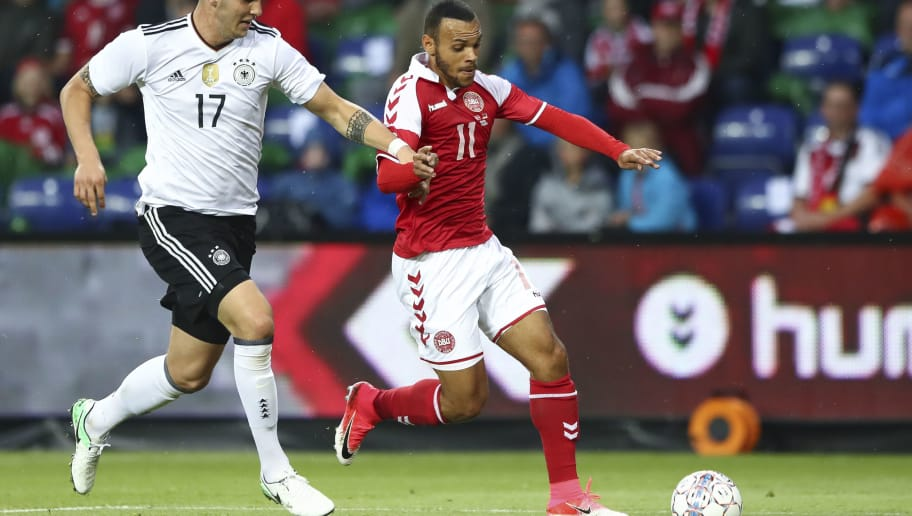 BRONDBY, DENMARK - JUNE 06: Niklas Suele of Germany and Martin Braithwaite of Denmark battle for the ball during the international friendly match between Denmark v Germany on June 6, 2017 in Brondby, Denmark. (Photo by Martin Rose/Bongarts/Getty Images)