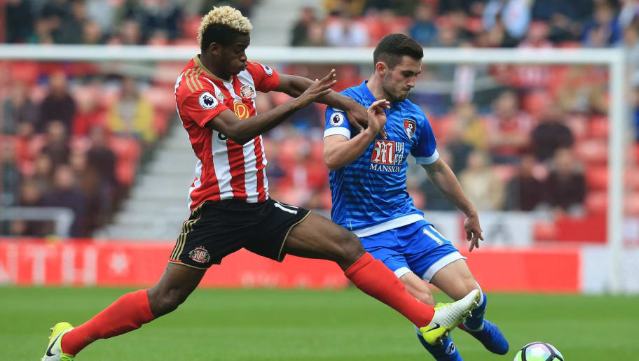 Sunderland's Gabonese midfielder Didier N'Dong (L) challenges Bournemouth's English midfielder Lewis Cook (R) during the English Premier League football match between Sunderland and Bournemouth at the Stadium of Light in Sunderland, north-east England on April 29, 2017.  / AFP PHOTO / Lindsey PARNABY / RESTRICTED TO EDITORIAL USE. No use with unauthorized audio, video, data, fixture lists, club/league logos or 'live' services. Online in-match use limited to 75 images, no video emulation. No use in betting, games or single club/league/player publications.  /         (Photo credit should read LINDSEY PARNABY/AFP/Getty Images)