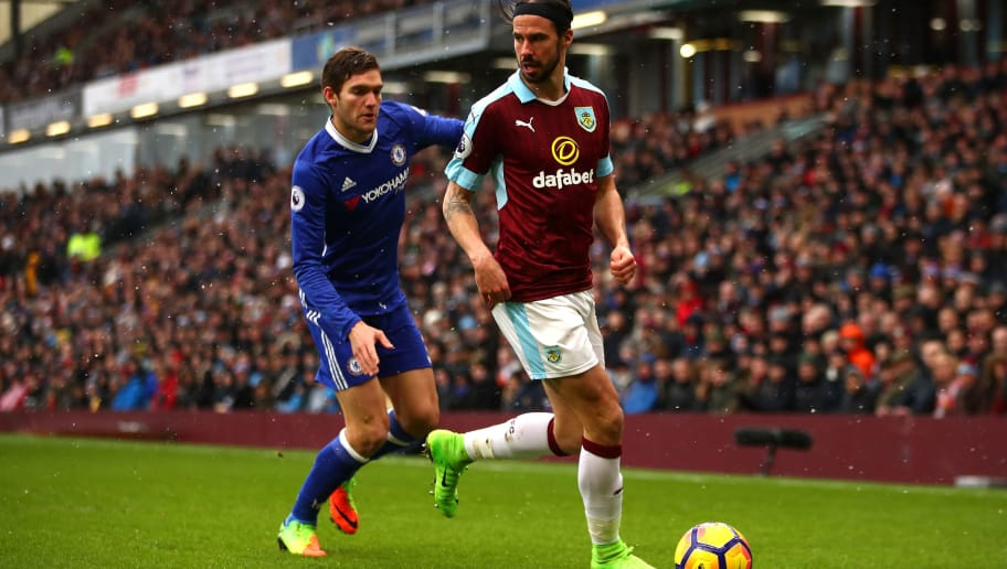 BURNLEY, ENGLAND - FEBRUARY 12:  George Boyd of Burnley is closed down by Marcos Alonso of Chelsea during the Premier League match between Burnley and Chelsea at Turf Moor on February 12, 2017 in Burnley, England.  (Photo by Clive Brunskill/Getty Images)