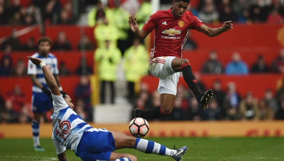 Manchester United's English striker Marcus Rashford (R) leaps a challenge from Reading's English defender Liam Moore (L) during the English FA Cup third round football match between Manchester United and Reading at Old Trafford in Manchester, north west England, on January 7, 2017. / AFP / Oli SCARFF / RESTRICTED TO EDITORIAL USE. No use with unauthorized audio, video, data, fixture lists, club/league logos or 'live' services. Online in-match use limited to 75 images, no video emulation. No use in betting, games or single club/league/player publications.  /         (Photo credit should read OLI SCARFF/AFP/Getty Images)