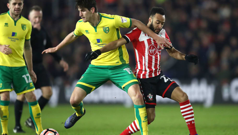 SOUTHAMPTON, ENGLAND - JANUARY 18: Timm Klose of Norwich City is challenged by Nathan Redmond of Southampton during The Emirates FA Cup Third Round Replay match between Southampton and Norwich City at St Mary's Stadium on January 18, 2017 in Southampton, England.  (Photo by Julian Finney/Getty Images)