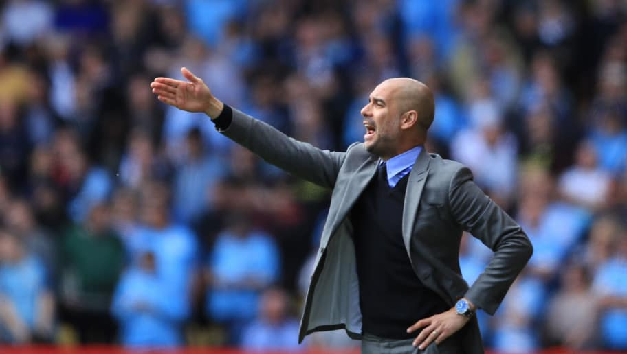 WATFORD, ENGLAND - MAY 21:  Manchester City manager Pep Guardiola gives instructions during the Premier League match between Watford and Manchester City at Vicarage Road on May 21, 2017 in Watford, England.  (Photo by Richard Heathcote/Getty Images)