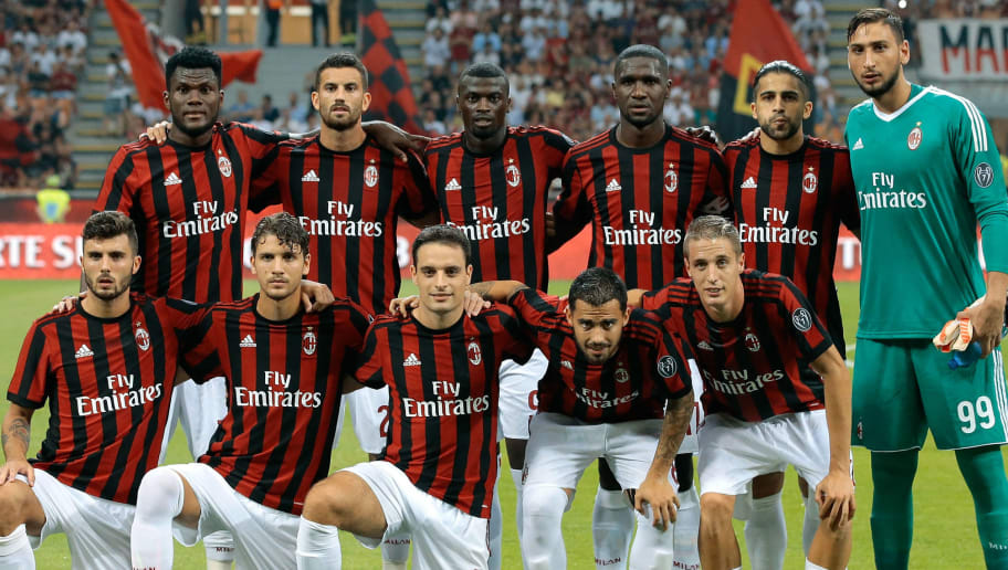 MILAN, ITALY - AUGUST 03: AC Milan team line up before the UEFA Europa League Third Qualifying Round Second Leg match between AC Milan and CSU Craiova at Stadio Giuseppe Meazza on August 3, 2017 in Milan, Italy.  (Photo by Emilio Andreoli/Getty Images)