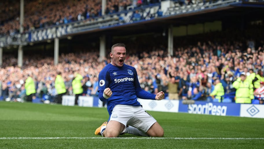 Everton's English striker Wayne Rooney celebrates scoring the opening goal during the English Premier League football match between Everton and Stoke City at Goodison Park in Liverpool, north west England on August 12, 2017. / AFP PHOTO / Oli SCARFF / RESTRICTED TO EDITORIAL USE. No use with unauthorized audio, video, data, fixture lists, club/league logos or 'live' services. Online in-match use limited to 75 images, no video emulation. No use in betting, games or single club/league/player publications.  /         (Photo credit should read OLI SCARFF/AFP/Getty Images)