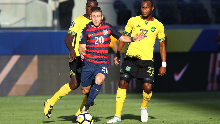 SANTA CLARA, CA - JULY 26:  #20 Paul Arriola of the United States dribbles past #22 Romario Williams of Jamaica and #15 Je-Vaughn Watson of Jamaica during the 2017 CONCACAF Gold Cup Final at Levi's Stadium on July 26, 2017 in Santa Clara, California.  (Photo by Ezra Shaw/Getty Images)