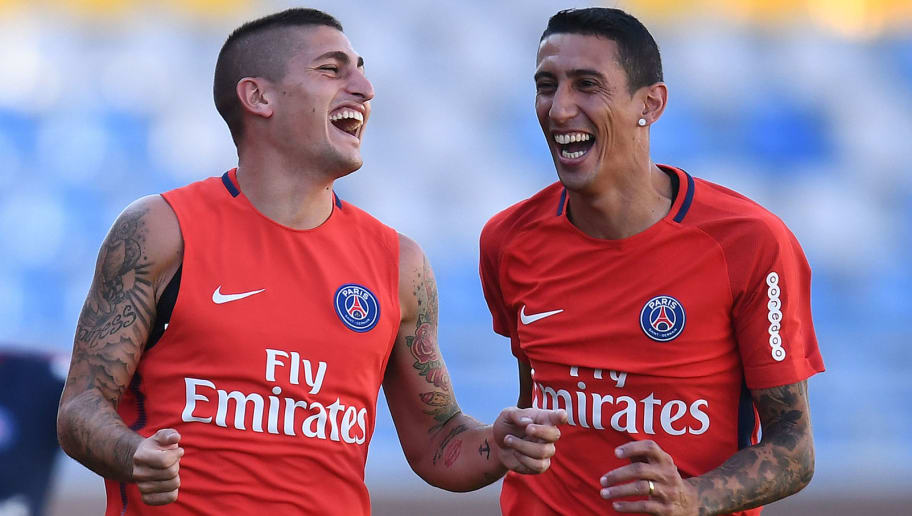 Paris Saint-Germain's Italian midfielder Marco Verratti (L) shares a laugh with Paris Saint-Germain's Argentinian forward Angel Di Maria during a training session at the Grand Stade in Tangiers on July 28, 2017 on the eve of the French Trophy of Champions (Trophee des Champions) football match between Paris Saint-Germain and Monaco. / AFP PHOTO / FRANCK FIFE        (Photo credit should read FRANCK FIFE/AFP/Getty Images)