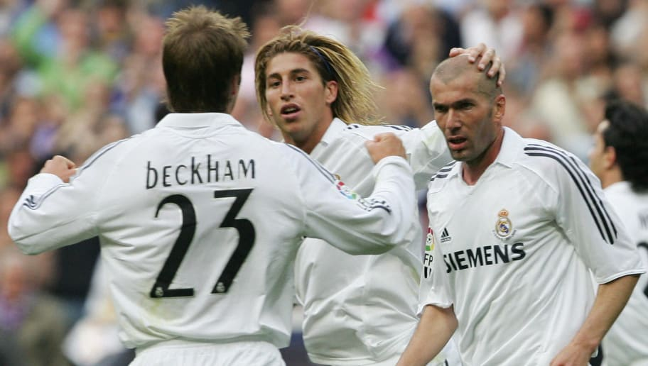 Madrid, SPAIN:  Real Madrid's Zinedine Zidane (R) celebrates with Sergio Ramos (C) and David Beckham after scoring against Villarreal during a Spanish league football match at the Santiago Bernabeu in Madrid, 07 May 2006. AFP PHOTO/PHILIPPE DESMAZES  (Photo credit should read PHILIPPE DESMAZES/AFP/Getty Images)