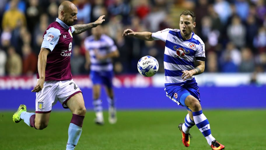 READING, ENGLAND - OCTOBER 18:  Alan Hutton of Aston Villa clears the ball as Roy Beerens of Reading during the Sky Bet Championship match between Reading and Aston Villa at Madejski Stadium on October 18, 2016 in Reading, England.  (Photo by Warren Little/Getty Images)
