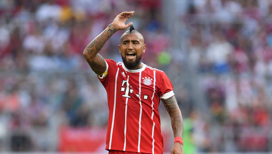 Bayern Munich's Chilian midfielder Arturo Vidal reacts during the third place Audi Cup football match between SSC Napoli and Bayern Munich in the stadium in Munich, southern Germany, on August 2, 2017.  / AFP PHOTO / Christof STACHE        (Photo credit should read CHRISTOF STACHE/AFP/Getty Images)