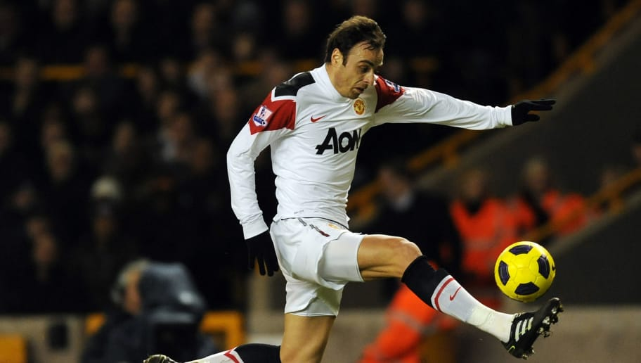 Manchester United's Bulgarian striker Dimitar Berbatov jumps to control the ball during the English Premier League football match between Wolverhampton Wanderers and Manchester United at Molineux Stadium in Wolverhampton, West Midlands, England on February 5, 2011. The game finished 2 - 1 to Wolves, it was Manchester United's first defeat of the 2010/11 season. AFP PHOTO/ADRIAN DENNISFOR EDITORIAL USE ONLY Additional licence required for any commercial/promotional use or use on TV or internet (except identical online version of newspaper) of Premier League/Football League photos. Tel DataCo +44 207 2981656. Do not alter/modify photo. (Photo credit should read ADRIAN DENNIS/AFP/Getty Images)