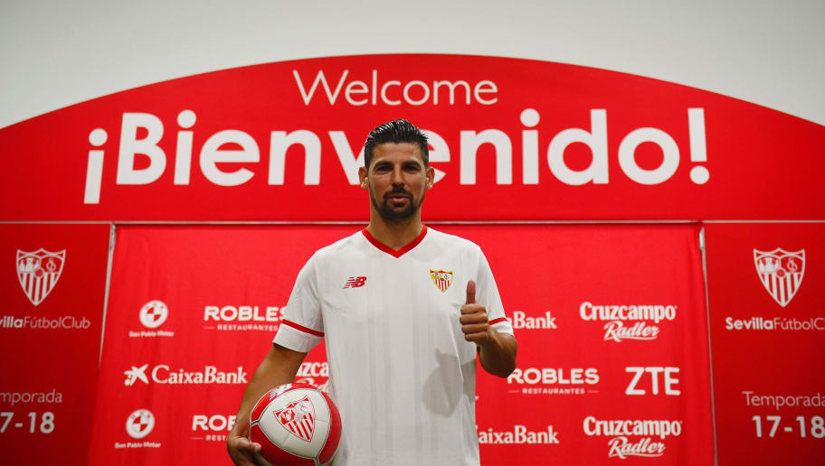 Sevilla's new signing Spaniard Manuel Agudo Duran 'Nolito' poses with a ball during his official presentation at the Sanchez Pizjuam stadium in Sevilla on July 26, 2017. / AFP PHOTO / CRISTINA QUICLER        (Photo credit should read CRISTINA QUICLER/AFP/Getty Images)