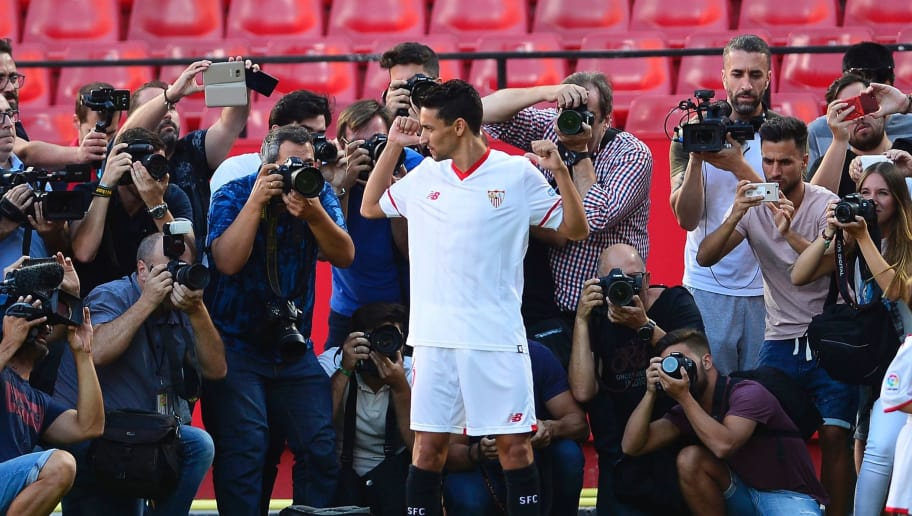 Sevilla's new footballer Jesus Navas (C) poses for photographers after addressing a press conference at his presentation at The Sanchez Pizjuam Stadium in Sevilla on August 2, 2017. / AFP PHOTO / CRISTINA QUICLER        (Photo credit should read CRISTINA QUICLER/AFP/Getty Images)