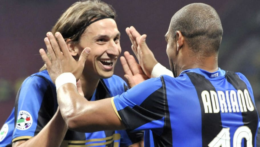 Inter Milan's Swedish forward Zlatan Ibrahimovic (L) celebrates with teammate, Brazilian forward Adriano after he scored against Bologna during their Italian Serie A match at San Siro Stadium in Milan, on October 4, 2008. AFP PHOTO / DAMIEN MEYER (Photo credit should read DAMIEN MEYER/AFP/Getty Images)