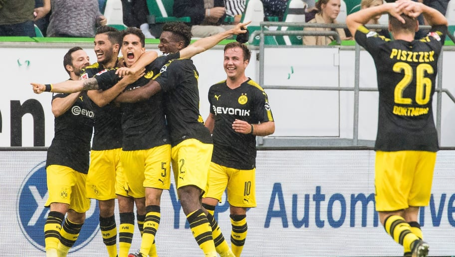 Dortmund´s Spanish defender Marc Bartra (C) celebrates scoring his teams' second goal with team mates during the German first division Bundesliga football match Wolfsburg v Dortmund at the Volkswagen arena in Wolfsburg on August 19, 2017. / AFP PHOTO / Odd ANDERSEN / RESTRICTIONS: DURING MATCH TIME: DFL RULES TO LIMIT THE ONLINE USAGE TO 15 PICTURES PER MATCH AND FORBID IMAGE SEQUENCES TO SIMULATE VIDEO. == RESTRICTED TO EDITORIAL USE == FOR FURTHER QUERIES PLEASE CONTACT DFL DIRECTLY AT + 49 69 650050         (Photo credit should read ODD ANDERSEN/AFP/Getty Images)