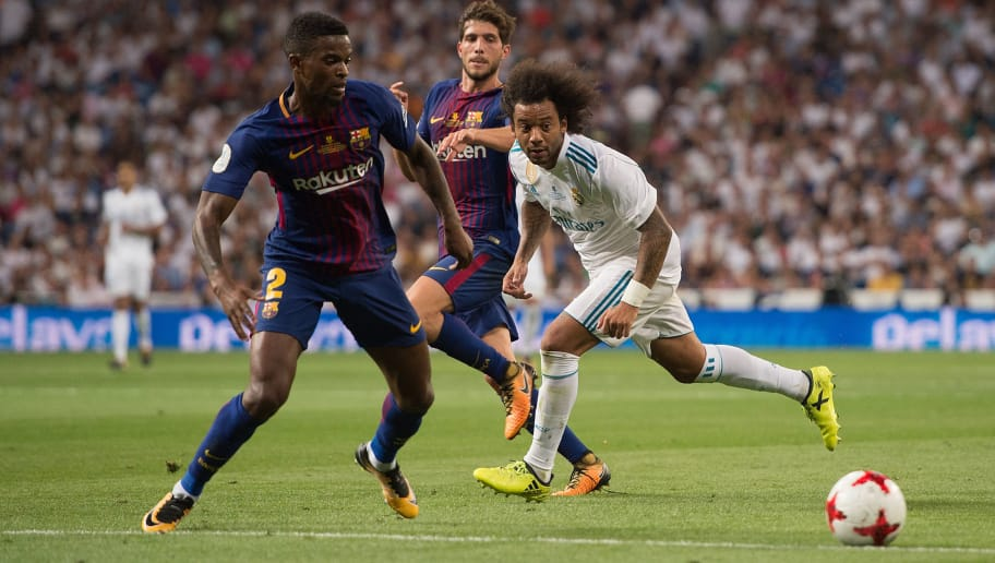 MADRID, SPAIN - AUGUST 16: Marcelo of Real Madrid passes the ball away from Nelson Semedo of FC Barcelona during the Supercopa de Espana Final 2nd Leg match between Real Madrid and FC Barcelona at Estadio Santiago Bernabeu on August 16, 2017 in Madrid, Spain. (Photo by Denis Doyle/Getty Images)