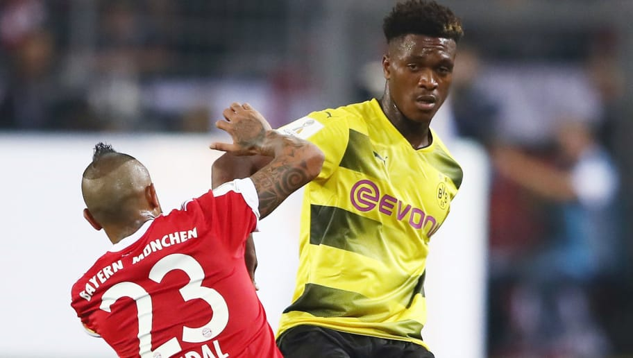 DORTMUND, GERMANY - AUGUST 05:  Dan-Axel Zagadou of Dortmund is challenged by Arturo Vidal of Muenchen during the DFL Supercup 2017 match between Borussia Dortmund and Bayern Muenchen at Signal Iduna Park on August 5, 2017 in Dortmund, Germany.  (Photo by Alex Grimm/Bongarts/Getty Images )