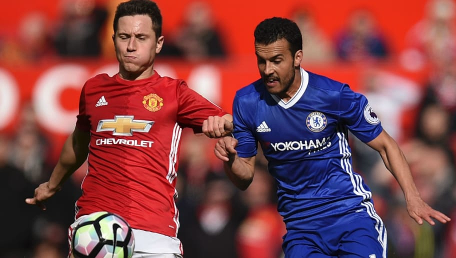 Manchester United's Spanish midfielder Ander Herrera (L) vies with Chelsea's Spanish midfielder Pedro (R) during the English Premier League football match between Manchester United and Chelsea at Old Trafford in Manchester, north west England, on April 16, 2017. / AFP PHOTO / Oli SCARFF / RESTRICTED TO EDITORIAL USE. No use with unauthorized audio, video, data, fixture lists, club/league logos or 'live' services. Online in-match use limited to 75 images, no video emulation. No use in betting, games or single club/league/player publications.  /         (Photo credit should read OLI SCARFF/AFP/Getty Images)